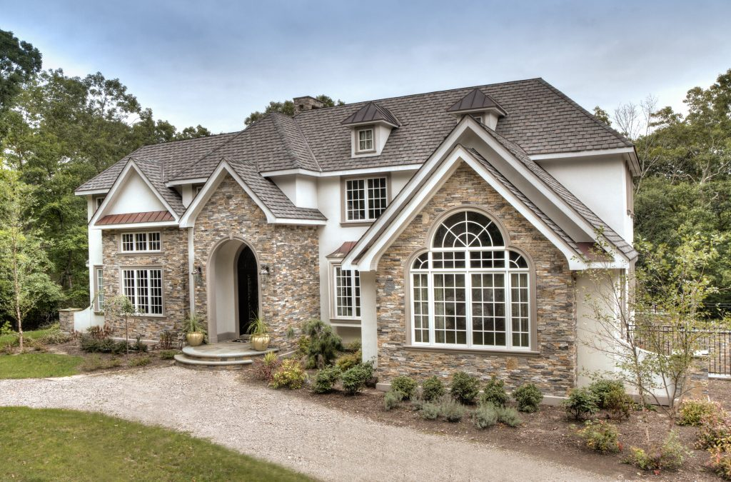 Stone veneer siding old station landscape masonry for Stone facade siding