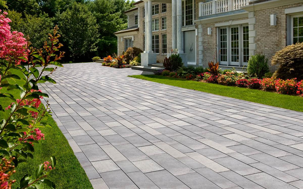 Why concrete pavers are better for driveways and patios for Temperature to pour concrete driveway